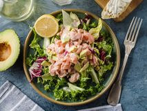 Ceviche is a traditional dish from Peru. Salmon marinated in lemon with fresh lettuce, avocado and onions. Peruvian food stock image