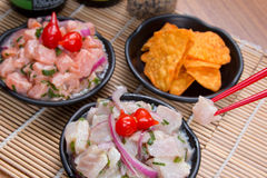 Ceviche Tuna and salmon. Japanese food background close diner Stock Images