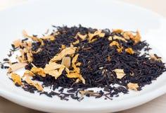Ceylon tea with sheet mango,in studio Royalty Free Stock Photography
