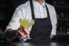 Barmen holds Cezaritz cocktail decorated with flower in glass ch stock photo