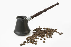 Cezve and coffee beans Stock Images