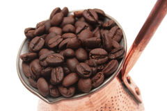 Cezve with coffee beans. Royalty Free Stock Photos