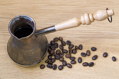 Cezve and coffee beans Kopi Luwak Royalty Free Stock Image