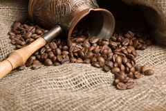 Cezve with freshly roasted coffee beans Stock Photos