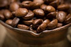 Cezve with freshly roasted coffee beans Stock Photography