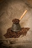 Cezve with freshly roasted coffee beans Royalty Free Stock Image