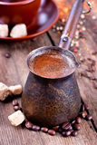 Cezve with hot coffee Stock Photo