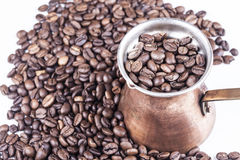 Cezve, ibrik and coffee beans. Saucepan for coffee and coffee beans on white royalty free stock image