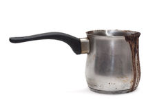 Cezve, turk. Coffee burnt and flowed over the edge. Dirty Turk for coffee Stock Images