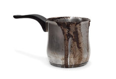 Cezve, turk. Coffee burnt and flowed over the edge. Dirty Turk for coffee Stock Photos