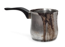 Cezve, turk. Coffee burnt and flowed over the edge. Dirty Turk for coffee Stock Photography