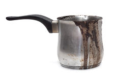 Cezve, turk. Coffee burnt and flowed over the edge. Dirty Turk for coffee Stock Image