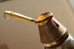Cezve and turkish coffee. Cezve and freshly made turkish coffee Stock Photos