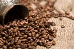 Cezve With Freshly Coffee Beans On Sackcloth Stock Photography