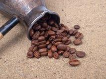 Cezve y granos de café Foto de archivo