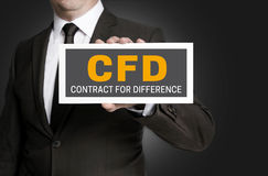 CFD sign is held by businessman Stock Image