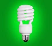 CFL在绿色的荧光灯电灯泡 库存照片