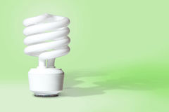 CFL Light Bulb on Green Background Royalty Free Stock Photos