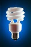 CFL lightbulb, aangestoken achter Stock Fotografie