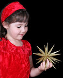 Cgirl in christmas dress holding gold star Stock Photos