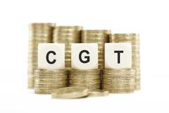 CGT (资本收益税)在被堆积的硬币隔绝了白色Backgrou 免版税库存照片
