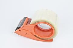 Cgummed paper utter. Orange color express gummed paper cutter Royalty Free Stock Images