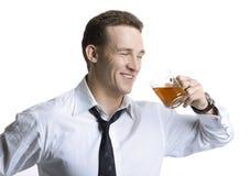 Chá bebendo do homem de negócios feliz Imagens de Stock