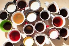 Chá, café e leite em uns copos de cima de Imagem de Stock