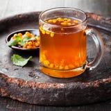 Chá com espinheiro cerval de mar Foto de Stock Royalty Free