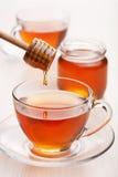 Chá com mel imagens de stock royalty free