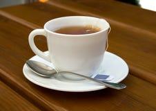 Chá, copo, colher, madeira, tabela Fotografia de Stock Royalty Free