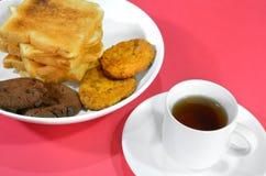 Chá e petisco Fotografia de Stock