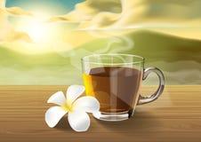 Chá e plumeria na tabela de madeira na manhã Foto de Stock Royalty Free