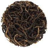 Chá preto do mandril selvagem de Yunnan na forma redonda isolado imagem de stock