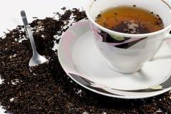 Chá preto em um copo Imagens de Stock