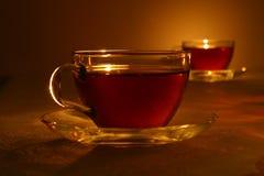 Chá preto no copo de cristal Fotos de Stock Royalty Free