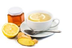 Chá quente do limão do gengibre do mel no copo Fotografia de Stock