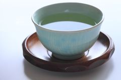 Chá verde no fundo branco Foto de Stock Royalty Free
