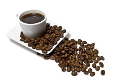 Chávena de café com grão de café Imagem de Stock Royalty Free