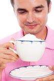 Chávena de café de sorriso da terra arrendada do homem Imagem de Stock