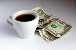 Chávena de café e dólares Fotos de Stock Royalty Free