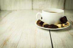 Chávena de café e doces Imagens de Stock