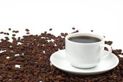 Chávena de café e grãos de café Imagem de Stock Royalty Free