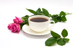 Chávena de café e rosas Fotografia de Stock Royalty Free