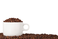 Chávena de café em feijões de café Fotos de Stock