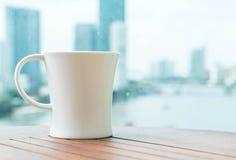Chávena de café na tabela Imagem de Stock