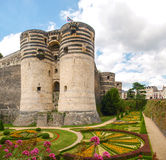 Château d'Angers. Angers, France - June 10, 2014: Château d'Angers. View of the walls of the castle and gardens around stock images