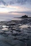 Château de Bamburgh au lever de soleil Photo stock