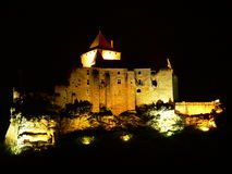 Château de Castelnaud-la-Chapele ( France ). Castelnaud medieval castle in the Dordogne at night Royalty Free Stock Images