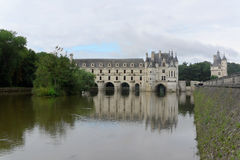 The Château de Chenonceau. The Château de Chenonceau, also spelled Chenonceaux, is a French castle spanning the River Cher, near the small village of Royalty Free Stock Photos